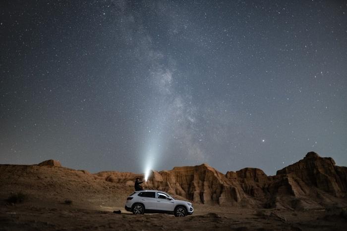 car lighting the sky